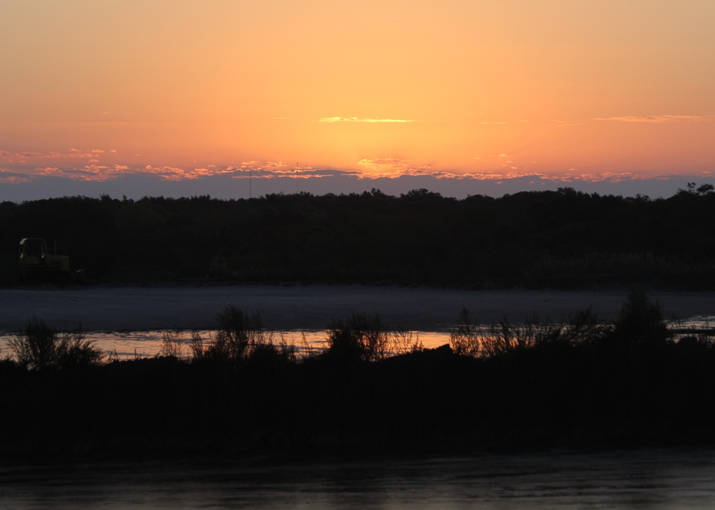 Sunrise over the dike at Higbee Beach